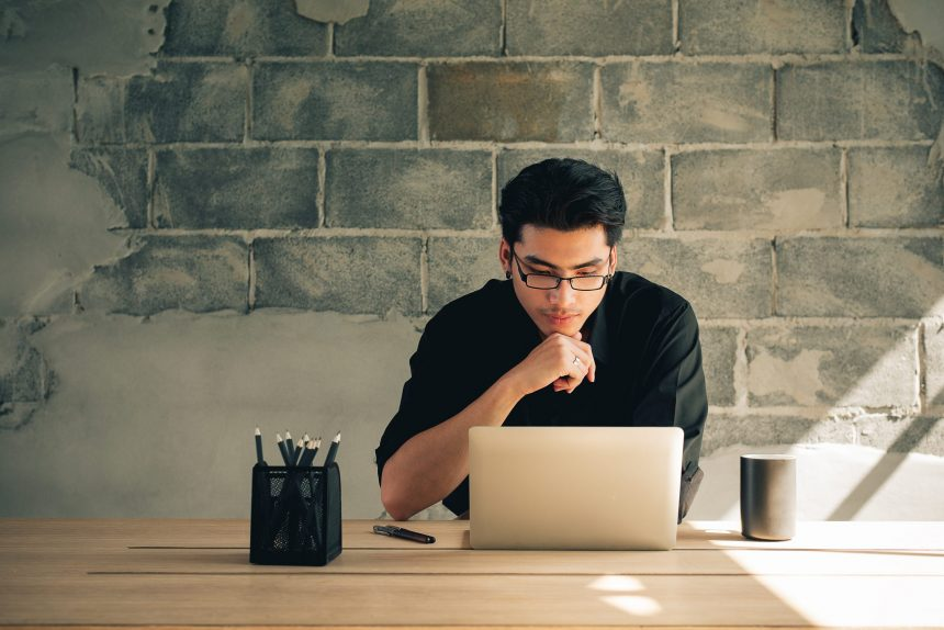 Man searching how to hire a virtual assistant