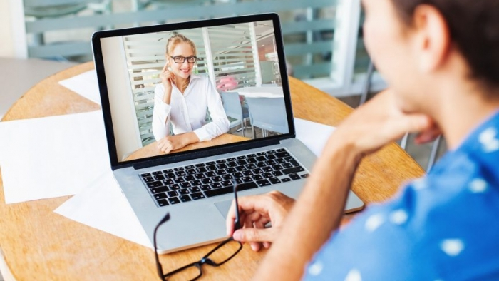 A client talking to a virtual assistant after getting the best answer on what is a va