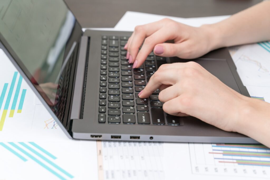 freelance writer for hire using her laptop to respond to job post