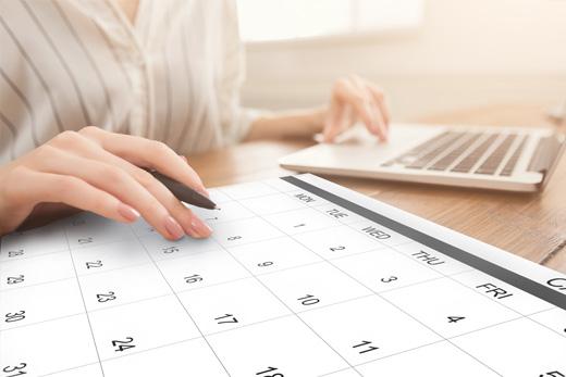 calendar manager plotting client's schedule